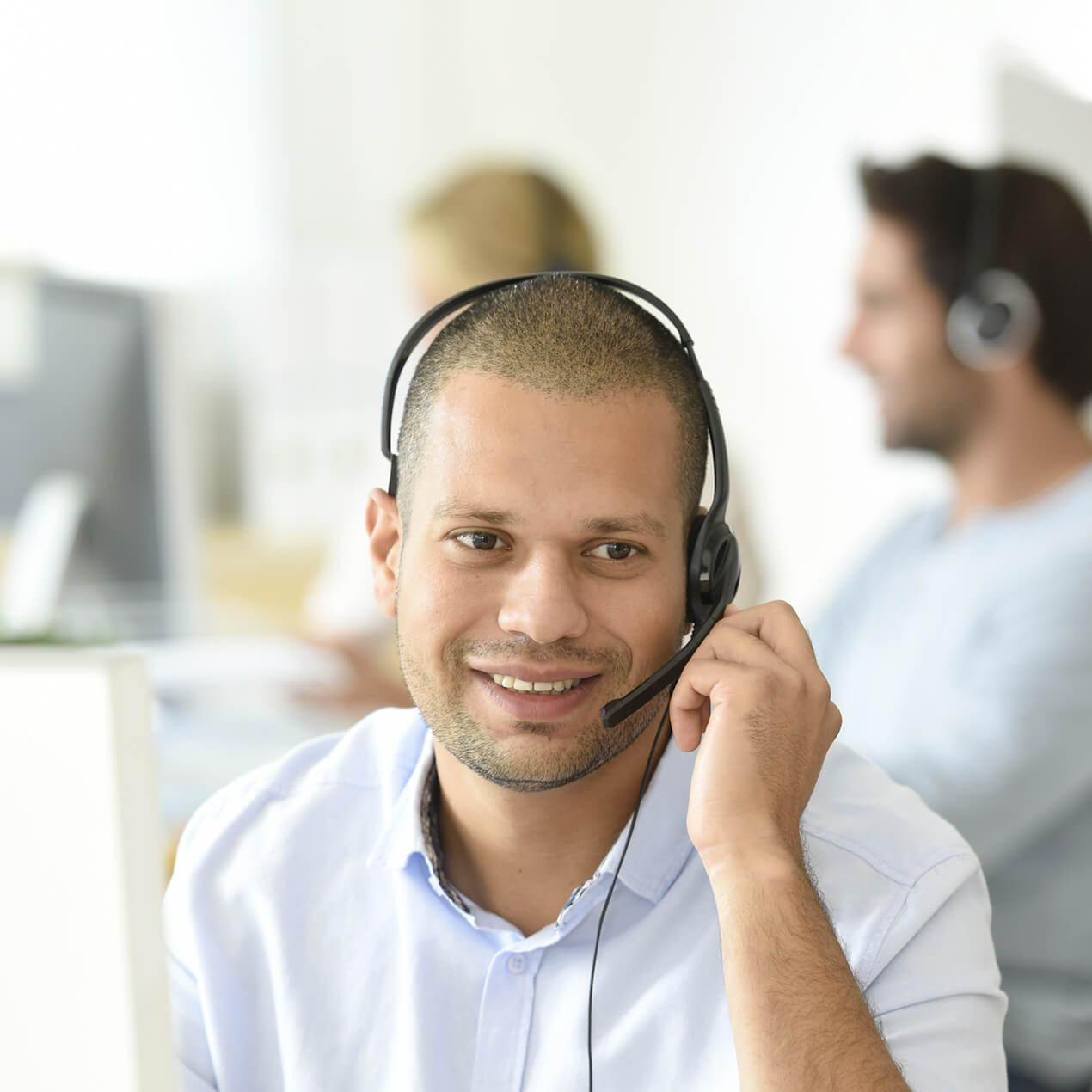 Male Working In Contact Center Wearing Headset